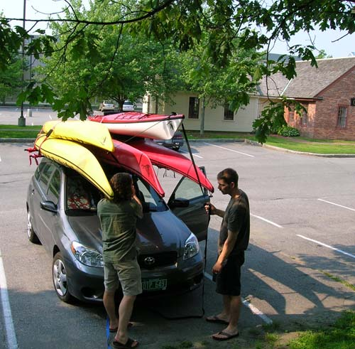 Car loaded up with kayaks